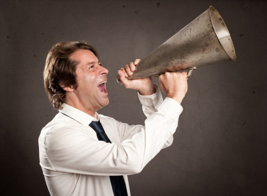 businessman shouting with an old megaphone